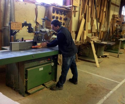 Our factory chief, Olivier is here working on wood with a wood shaper.